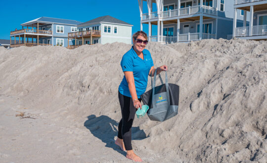 Staff cleaning beachfront